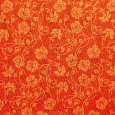 Tela patchwork: entramado de campanillas en naranja