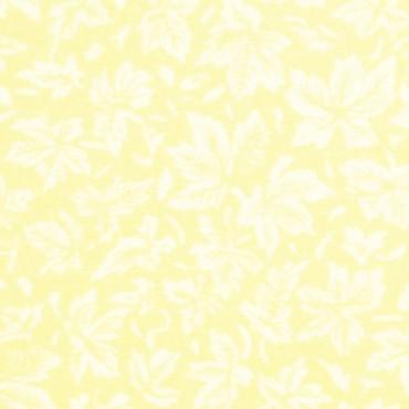 Hojas de arce sobre amarillo crema