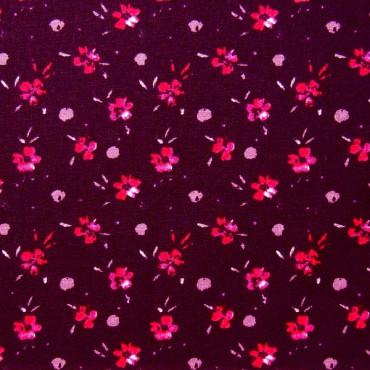 Tela patchwork flores fucsia sobre rojo púrpura