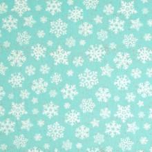 Tela patchwork cristales de nieve sobre turquesa