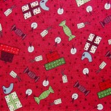 Tela patchwork de Navidad Festive Fun regalos sobre rojo 1